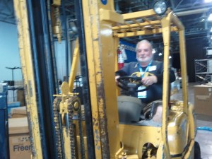 Me, driving a forklift at EMC World 2012.